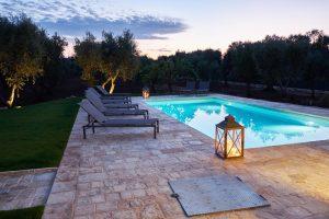 sun setting over luxury vacation villa