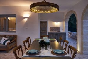 dining table by night luxury villa Puglia